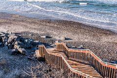 Staircase Leading Down to Stone-Covered South Carlsbad State Beach royalty free stock image