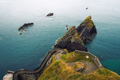 Staircase leading to the Dunquin Pier in Ireland stock photos