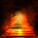 Staircase leading to heaven or hell. Light at the End of the Tunnel Royalty Free Stock Photography