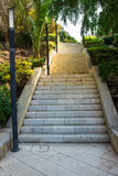 Staircase leading up to Santa Barbara mountain fortress in Ereta park, Alicante. Costa Blanca, green trees, summer Stock Image