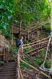 A staircase leading uphill and a tourist Royalty Free Stock Photo