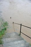 Staircase that leads down to the River during the flood Royalty Free Stock Photo