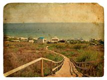 A staircase leads down to the sea. Old postcard. Stock Photography