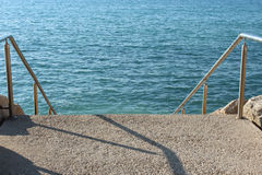 Staircase leads to the sea Stock Images