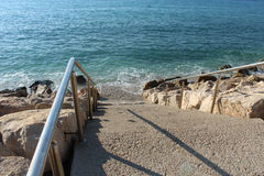 Staircase leads to the sea Royalty Free Stock Photos