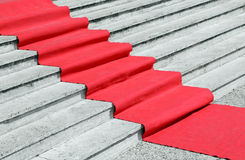 Staircase with a luxurious red carpet to welcome VIPs. Long staircase with a luxurious red carpet to welcome VIPs royalty free stock photos