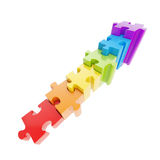 Staircase made of glossy puzzle jigsaw pieces. Staircase made of glossy rainbow colored puzzle jigsaw pieces isolated on white stock illustration