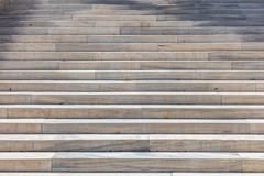 Staircase of marble. Long stairs for background. White and grey stairway. Empty, close up view, details royalty free stock photos