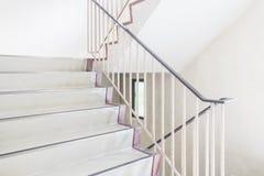 Staircase with metallic handrai Stock Photo