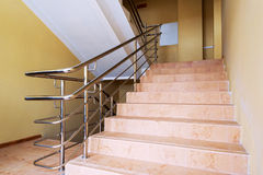 Staircase with metallic handrails Royalty Free Stock Images