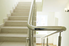Staircase in modern building. Closeup stainless steel handrails royalty free stock photos