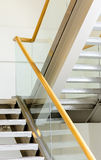 Staircase. Modern metal and wooden staircase Royalty Free Stock Photography