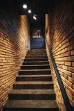 Staircase in old cellar with brick walls. Loft staircase with brick walls royalty free stock photos