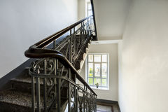 Staircase with old, decorative railing stock photography
