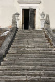 Staircase. Old weathered stone castle staircase and open wooden door Stock Images