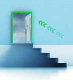 Staircase passage with direction arrow and door Stock Images