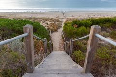 A staircase and path on to the beach at Victor Harbour near the groynes o the Fleurieu Peninsula South AUstralia on 3rd April 2019. Staircase and path on to the royalty free stock image