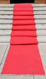 Staircase with red carpet and the access door open Royalty Free Stock Image