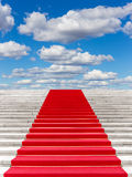 Staircase with red carpet Royalty Free Stock Image