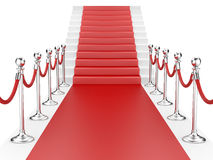Staircase and red carpet between two metallic stanchions with ro Royalty Free Stock Photography