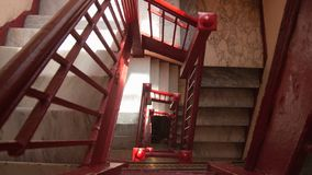 Staircase red paint four stories in tenement build in new york city stock images
