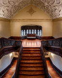 Staircase sofa. Lone sofa on grand staircase in Ida Noyes Hall on the campus of the University of Chicago in Chicago, Illinois Stock Photo