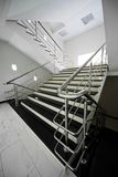 Staircase with a steel handrail Royalty Free Stock Image
