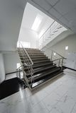 Staircase with a steel handrail Royalty Free Stock Photos