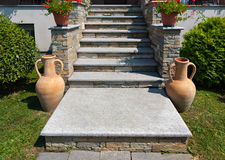 Staircase stone. Natural stone stairs in a beautiful home garden Stock Photos