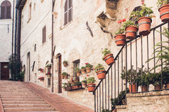 Staircase street of the old town of Assisi with ancient stone h Royalty Free Stock Photography