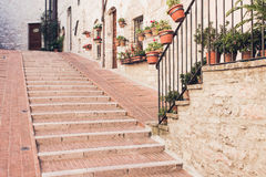 Staircase street of the old town of Assisi with ancient stone h Royalty Free Stock Photos