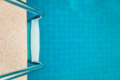 Staircase into the swimming pool Royalty Free Stock Photos