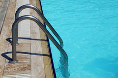 Staircase in the swimming pool Royalty Free Stock Photos