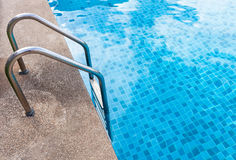 Staircase into the swimming pool with blue tiled. View from eye Royalty Free Stock Photography