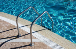 Staircase in swimming pool Stock Photos