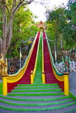 Staircase in temple, Naka statue. Thai art, large colored staircase in temple, Naka statue on staircase balustrade at Thai Buddhist pagoda, Tiger cave Temple in Stock Photos