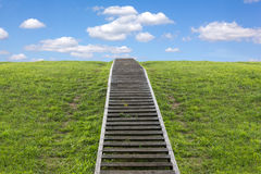 Staircase to heaven. Huge stairway leading up a green hill Royalty Free Stock Photos