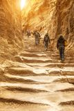 Staircase to monastery of Petra. Travelers and tourists climb the impressive staircase carved into the rock that leads to the monastery of Petra. Jordan stock images