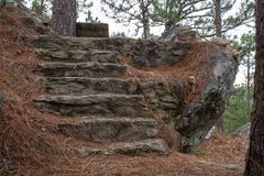 Staircase to Nowhere. A flight of abandoned and forgotten stone steps, deep in the middle of the wilderness royalty free stock image