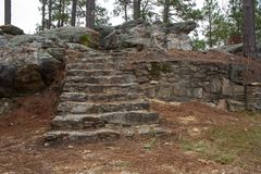 Staircase to Nowhere. A flight of abandoned and forgotten stone steps, deep in the middle of the wilderness royalty free stock photo