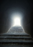 Staircase in the tunnel with light at the end Royalty Free Stock Images