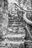 Staircase vertical landscape of rustic stone and wood railings Royalty Free Stock Image