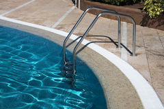 Staircase in water swiming pool. Staircase in blue water swiming pool Stock Photography