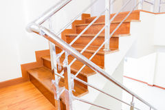 Staircase wooden. Home building interior empty room design staircase concrete top wood stainless steel handrails royalty free stock image