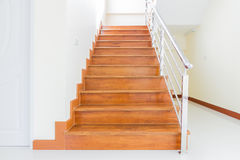 Staircase wooden. Home building interior empty room design staircase concrete top wood stainless steel handrails royalty free stock photos