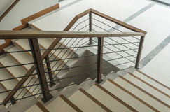 Staircase with wooden rail Stock Photo