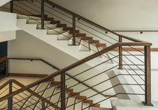 Staircase with wooden rail Stock Photography