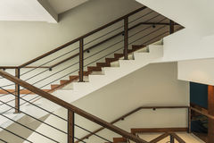 Staircase with wooden rail Stock Photos