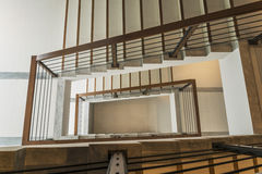Staircase with wooden rail Royalty Free Stock Photo