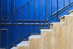 Staircases with blue wall background Stock Image